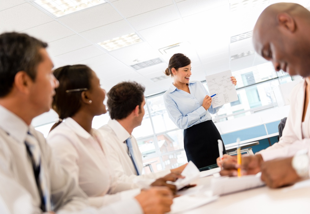 Woman making a presentation in a successful business meeting